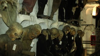 A group of well dressed mummified people in the capuchin catacomb