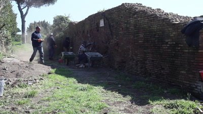 People restoring historical building in Ostia Antica