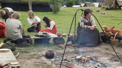 Vikings,yopung vikings by the fire,event takin place at Trelleborg ring castle,Denmark