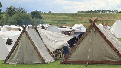 vikings,trading people,event takin place at Trelleborg ring castle,the ring castle in the back,Denmark
