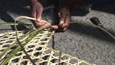 Weaving a traditional fishpot out of bamboo,