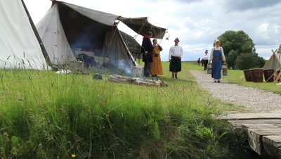 Vikings,trading people,event takin place at Trelleborg ring castle,reconstructed vikinghouse in the back,Denmark