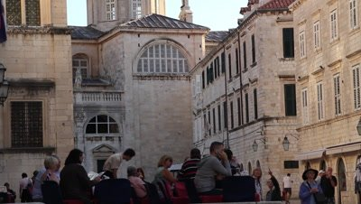 tourists resting in the street of old Dubrovnik,churce and old buildings