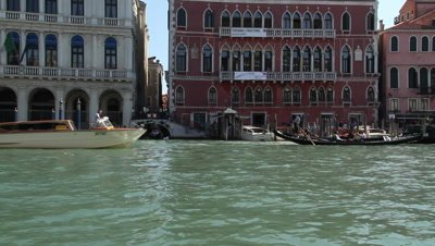 gondols and taxi-boat traffic on the cahanal Grande in Venice