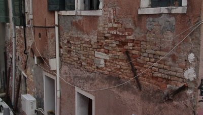 the walls are collapsing in the city of venice,lots of repair is ongoing