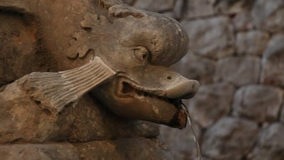 a carved fishhead in a fountain in the old city of Dubrovnik