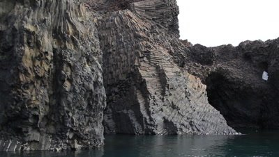 columnar basalt rocks at the coast formed as a result of the cooling process of volcanic lava
