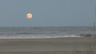 full moon rise over ocean