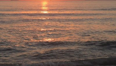 rich red gold ocean and long sun reflection