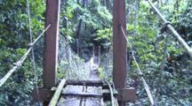 Walking Over Suspension Bridge To Jungle Trail