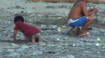 Rubbish On Beach-Kids Playing