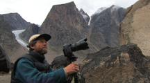 Photographer In Auyuittuq National Park, Glacier In Background, Baffin Island