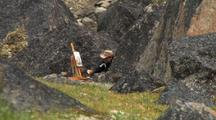 Artist Painting In Auyuittuq National Park, Baffin Island