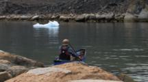Canoeing Towards Ice On Ocean, Near Qikitarjuaq, Baffin Island