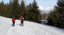 Couple Snowshoeing In Glacier National Park, Montana, USA. (MR)