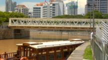 Singapore Downtown River In Fullerton Area Of Clarke Quay With Tug Boat On Water