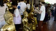Thailand, Ayutthaya. Wat Phra Chao Phya-Thai (Aka Wat Yai Chai-Mongkol). UNESCO, Historic Monastery C.1357. Temple Visitors Place Small Gold Leaf Squares On Buddha Statues As Offering. (UR)