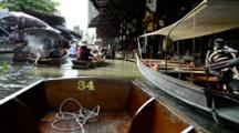 Thailand, Damnoen Saduak Floating Market. Thai Waterway Filled With Local Boats Selling Produce, Food & Souvenirs. (UR)