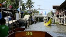 Thailand, Damnoen Saduak Floating Market. Thai Waterway Filled With Tourist Sightseeing Boats And Locals In Typical Long-Tail Speed Boats. (UR)