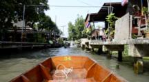 Thailand, Damnoen Saduak Floating Market. Thai Waterway Filled With Tourist Sightseeing Boats And Typical Long-Tail Speed Boats Racing Through Waterfront Neighborhood. (UR)