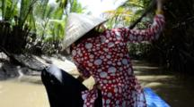 Vietnam, Outskirts Of Ho Chi Minh City (Aka Saigon). My Tho, Mekong River Delta. View Of Narrow Waterway From Typical Sampan Boat With Female Driver In Traditional Straw Conical Hat.