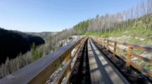 Mike Deme Rides Across Trestle In Myra Canyon On The Kettle Valley Railway Bike Path Near Kelowna British Columbia Canada