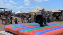 Galisteo, New Mexico, United States. Young Cowboy Rides Mechanical Bull At Small Town Rodeo