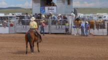 Galisteo, New Mexico, United States. Saddle Bronc Cowboy Rider At Authentic Small Town Rodeo