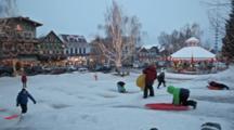 WA, Leavenworth, Bavarian Style Village, Gazebo At City Park, Kids Playing In The Snow