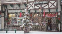 WA, Leavenworth, Bavarian Style Village, Front Street, Snowing, Man With Dog