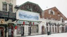 WA, Leavenworth, Bavarian Style Village, Front Street, Snowing