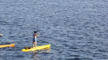 WA, Seattle, Lake Union, Stand-Up Paddle Boarders