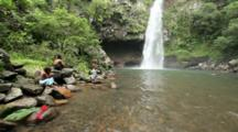 Young Boys Sitting At The Pool Area Of Bouma Falls On Taveuni Island In Fiji.  MR