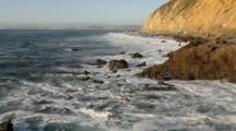 Waves Along Rocky Coast With Cliffs, Palos Verdes Peninsula, California; Redondo Beach In Background