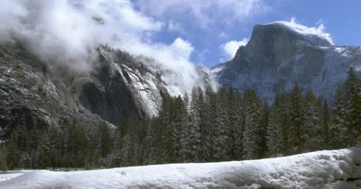 Yosemite Half Dome with clouds after snow storm