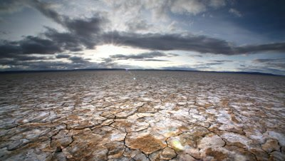 Dry cracked earth and clouds in the Alvord Desert, Oregon