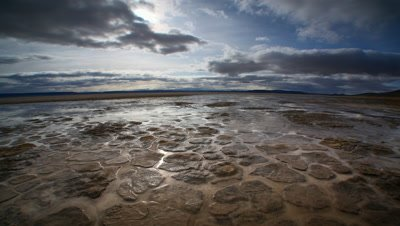 Muddy, cracked earth after storm in the Alvord Desert, Oregon