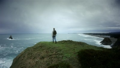 Young man hiking trail on Pacific Ocean,Cape Blanco state park,OR