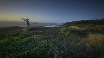 Woman with fabric in wind,Oregon Coast