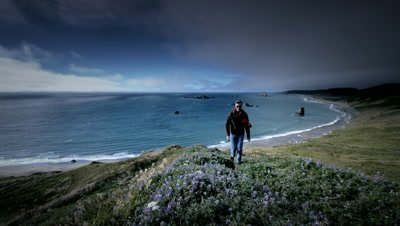 Man hiking trail overlooking the Pacific Ocean,Cape Blanco State Pk,OR