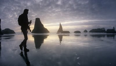 Woman hiking beach at sunset,Oregon Coast,Bandon,OR