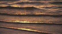 Waves Rippling Into Shore In Golden Light