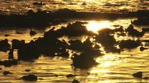 Golden Sunrise light reflections on water