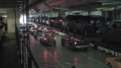 4K The cars leaves the cargo part of the ferry ship