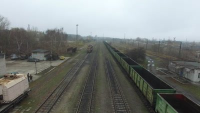 Aerial footage of a freight trains on a railroad station