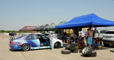 Drift cars in garage area during championship