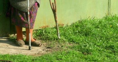 4k senior woman walking with crutches outdoor