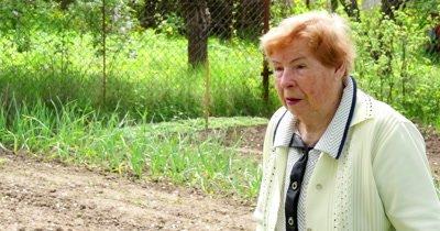 4k Elderly woman holding her walking stick