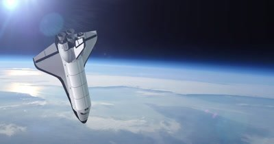 The Space Shuttle above the Earth in the background