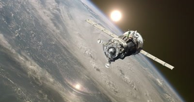 Cargo spacecraft Soyuz orbiting the Earth